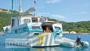 Pizza boat sailboat anchored - smiling woman in back window ready to take orders
